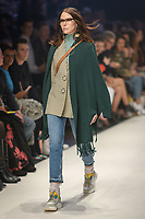 Melbourne, September 7, 2018 - A model wearing clothing from retailer Sandro Paris walks at the Town Hall Closing Runway show in Melbourne Fashion Week in Melbourne, Australia. Photo Sydney Low