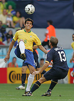 Brazilian midfielder (8) Kaka passes the ball over Australian midfielder (13) Vince Grella. Brazil defeated Australia 2-0 in their FIFA World Cup Group F match at the FIFA World Cup Stadium, Munich, Germany, June 18, 2006.
