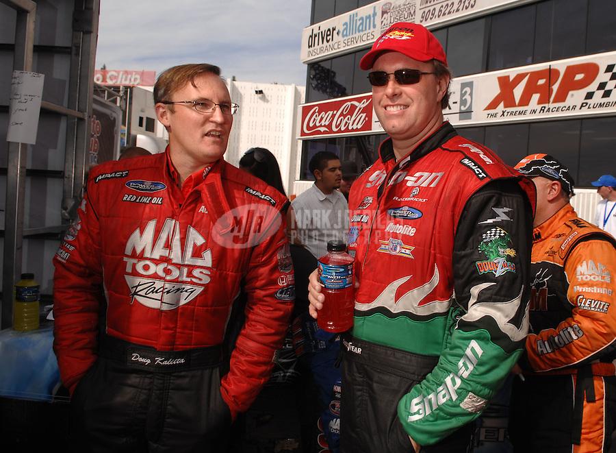 Nov 4, 2007; Pomona, CA, USA; NHRA top fuel dragster drivers Doug Kalitta (left) and Doug Herbert during the Auto Club Finals at Auto Club Raceway at Pomona. Mandatory Credit: Mark J. Rebilas-US PRESSWIRE