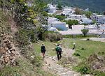 Walkers arriving at the village of Capileira, High Alpujarras, Sierra Nevada, Granada province, Spain