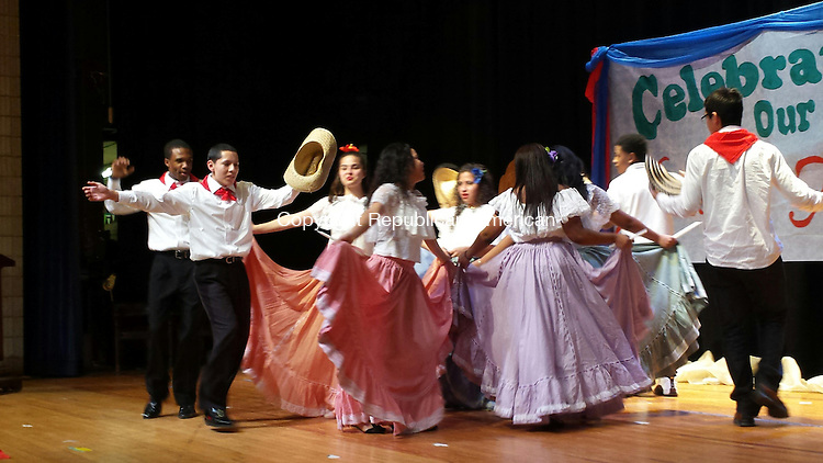 WATERBURY --  Crosby High School students perform a traditional dance during a celebration of Three Kings Day Friday.