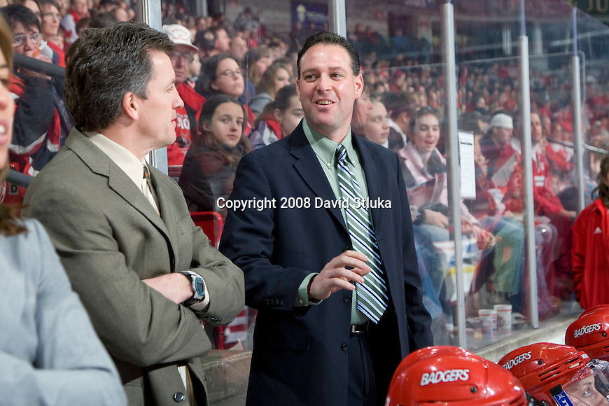 MADISON, WI - JANUARY 26: Assistant coach Dan Koch, right,  of the Wisconsin Badgers women's hockey team talks to head coach Mark Johnson during the game against the St. Cloud State Huskies at the Kohl Center on January 26, 2008 in Madison, Wisconsin. Wisconsin beat St. Cloud State 4-0. (Photo by David Stluka)
