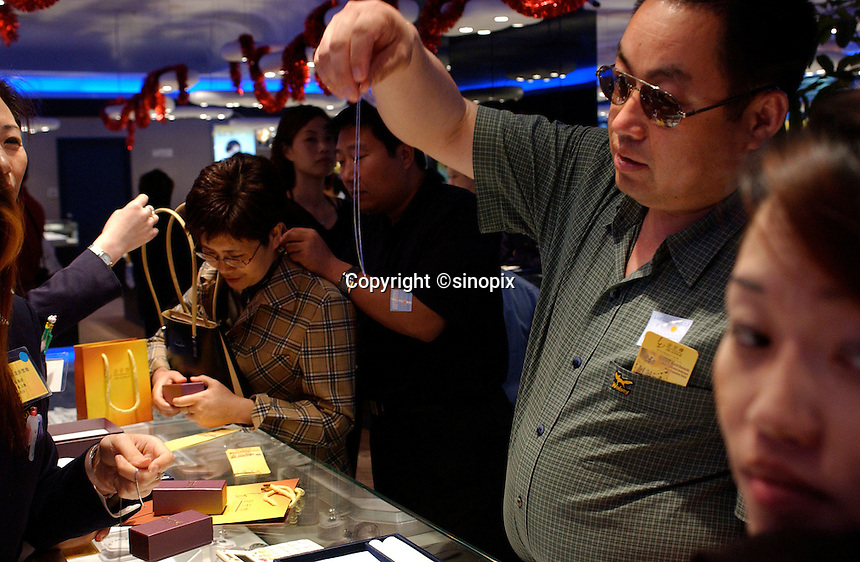 Tourists from Mainland China swamp a gold and jewellery shopping center in Hong Kong. Mainland tourists are affluent and spending more and more money on their travels abroad. They are widely credited as saving the Hong Kong economy..
