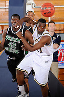 6 February 2010:  FIU's Cedric Essola (21) pursues a loose ball in the first half as the North Texas Mean Green defeated the FIU Golden Panthers, 68-66, at the U.S. Century Bank Arena in Miami, Florida.