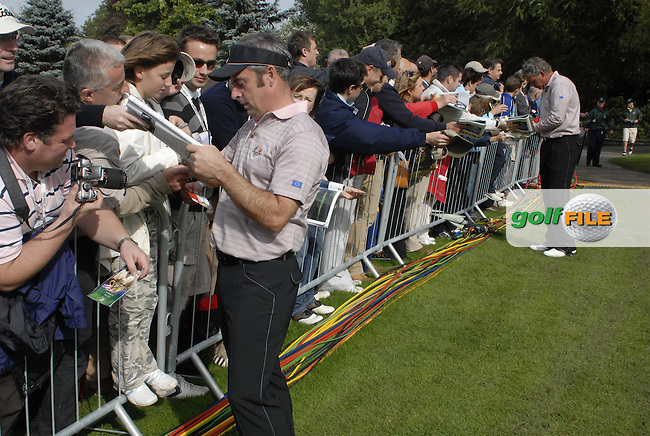 Irish players Paul McGinley and Darren Clarke sign autographs on their way to the 17th tee box during Practice Day1 of the 2006 Ryder Cup at The K Club Saturday 19th September 2006.(Photo Eoin Clarke/Newsfile)