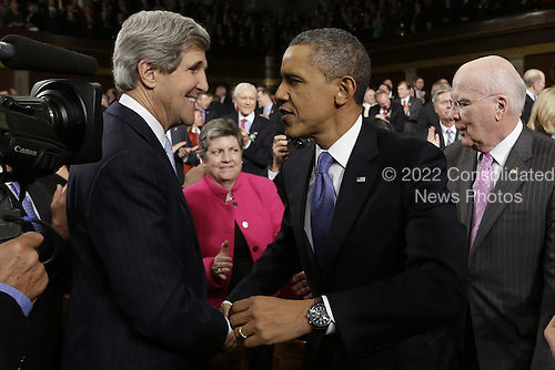 United States Secretary of State John Kerry greets U.S. President Barack Obama before the President's State of the Union address during a joint session of Congress on Capitol Hill in Washington, DC on February 12, 2013. U.S. Senator Patrick Leahy (Democrat of Vermont) is at right, and U.S. Secretary of Homeland Security Janet Napolitano is at center.    .Credit: Charles Dharapak / Pool via CNP