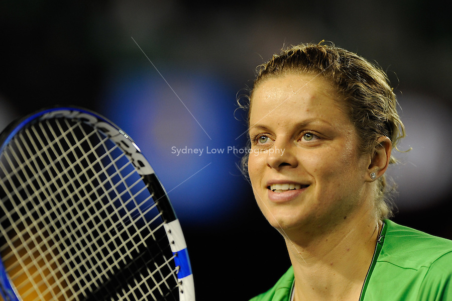 MELBOURNE, 25 JANUARY - Kim Clijsters (BEL) celebrates her win and tosses her wrist band to fans in her fourth round match against Ekaterina Makarova (RUS) on day eight of the 2011 Australian Open at Melbourne Park, Australia. (Photo Sydney Low / syd-low.com)