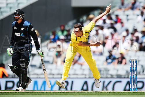 03.02.2016. Auckland, New Zealand.  Josh Hazlewood of Australia bowls as Martin Guptill of New Zealand looks on. ANZ International Series, 1st ODI between New Zealand Back Caps and Australia at Eden Park in Auckland, New Zealand.