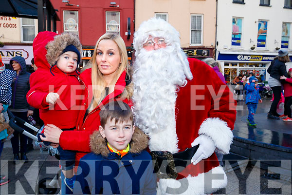 Evan, Antoinette and Nathan Hurley, pictured with Santa Claus at the CH Chemist Santa Parade in Tralee on Saturday last.