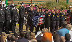 September 20, 2004 Angels Camp, California --Tuolumne Fire –- During memorial for fallen firefighter Eva Marie Schicke, the Ebbetts Pass Fire Crew with whom Schicke had previously worked, moves her casket from Engine 4474 and passes in front of Helitack 404's crew. The memorial service was held at the Calaveras County Fairgrounds.  The Tuolumne Fire was a small very fast-moving fire that started around noon on September 12, 2004 near Lumsden Bridge at the bottom of the Tuolumne River.  The fire moved rapidly up the 80-plus-degree slope catching Cal Fire Helitack firefighters, tragically killing firefighter Eva Marie Schicke and injuring five others.
