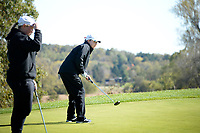 Edgewood's Grace Jaeger watches her putt on No. 8 during the Wisconsin WIAA state girls high school golf tournament on Monday, 10/14/19 at University Ridge Golf Course