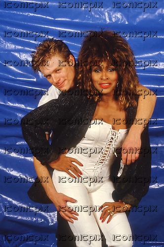 TINA TURNER and BRYAN ADAMS - backstage on the Private Dancer Tour at Wembley Arena London UK - March 1985.  Photo credit: Ray Palmer Archive/IconicPix
