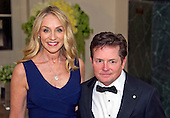 Actor Michael J. Fox, right, and Tracy Pollan, left, arrive for the State Dinner in honor of Prime Minister Trudeau and Mrs. Sophie Gr&eacute;goire Trudeau of Canada at the White House in Washington, DC on Thursday, March 10, 2016.<br /> Credit: Ron Sachs / Pool via CNP
