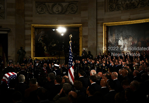 The casket of former US President George H.W. Bush lies in state in the US Capitol Rotunda as members of the US House leadersip look on in Washington, DC, December 3, 2018. (Photo by Brendan Smialowski / AFP)