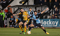 Sam Wood of Wycombe Wanderers & James Dunne of Cambridge United battle for the ball during the Sky Bet League 2 match between Cambridge United and Wycombe Wanderers at the R Costings Abbey Stadium, Cambridge, England on 1 March 2016. Photo by Andy Rowland / PRiME Media Images.