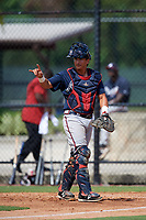 Atlanta Braves catcher Lucas Herbert (2) signals two outs during an Instructional League game against the Philadelphia Phillies on October 9, 2017 at the Carpenter Complex in Clearwater, Florida.  (Mike Janes/Four Seam Images)