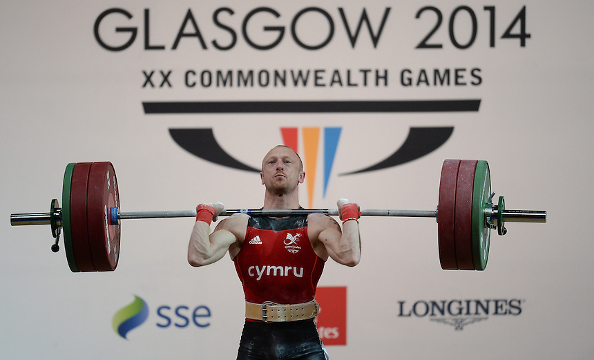 Wales Gareth Evans in action during todays session<br /> <br /> Photographer Ian Cook/CameraSport<br /> <br /> 20th Commonwealth Games - Weightlifting - Men's 62Kg -  Day 2 - Friday 25th July 2014 - Glasgow - UK<br /> <br /> &copy; CameraSport - 43 Linden Ave. Countesthorpe. Leicester. England. LE8 5PG - Tel: +44 (0) 116 277 4147 - admin@camerasport.com - www.camerasport.com