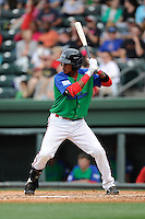 Infielder Deiner Lopez (5) of the Greenville Drive bats in a game against the Augusta GreenJackets on Sunday, April 12, 2015, at Fluor Field at the West End in Greenville, South Carolina. Augusta won, 2-1. (Tom Priddy/Four Seam Images)