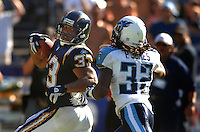 Sept. 17, 2006; San Diego, CA, USA; San Diego Chargers running back (33) Michael Turner looks back at Tennessee Titans cornerback (32) Pacman Jones at Qualcomm Stadium in San Diego, CA. Mandatory Credit: Mark J. Rebilas