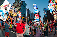 New York, NY - 11 July 2014 Tourists with cameras in Times Square ©Stacy Walsh Rosenstock/Alamy