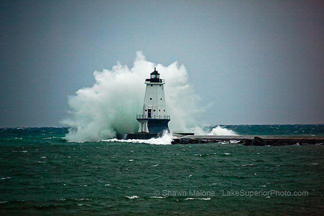Ludington Lighthouse and storm force waves lighthouses in the Upper Peninsula of Michigan