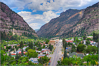 "The town of Ouray, Colorado, is a picturesque little place. Billing itself as Colorado's ""Little Switzerland,"" Ouray is enclosed by rising cliffs on three sides. Heading north, you can make your way to Ridgway, Colorado, on a relatively flat winding road. Nearby this town are wonderful opportunities for landscape photography, including Yankee Boy Basin and Engineer Pass (Four-wheel drive not included!). Heading south you'll wind over a pass and down into the historic town of Silverton."