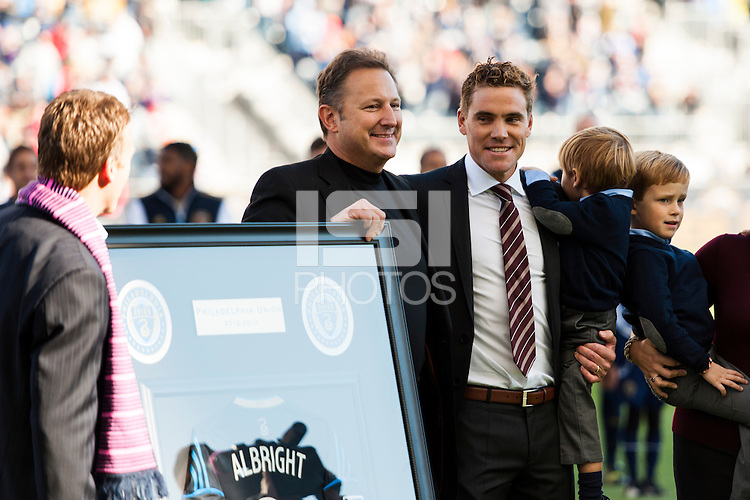 Chris Albright (3) of the Philadelphia Union is honored before the game by CEO Nick Sakiewicz and manager John Hackworth. Sporting Kansas City defeated the Philadelphia Union 2-1 during a Major League Soccer (MLS) match at PPL Park in Chester, PA, on October 26, 2013.