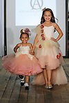 Child models walk runway in outfits from the Adrianna Ostrowska fashion show, during the KidFash Magazine runway show in Brooklyn, New York on Nov 4, 2017.