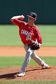 Team Canada pitcher Logan Seifrit #24 delivers a pitch delivers a pitch during a game vs the Nexen Heroes at Al Lang Field in St. Petersburg, Florida;  February 28, 2011.  Canada defeated Nexen 2-0.  Photo By Mike Janes/Four Seam Images