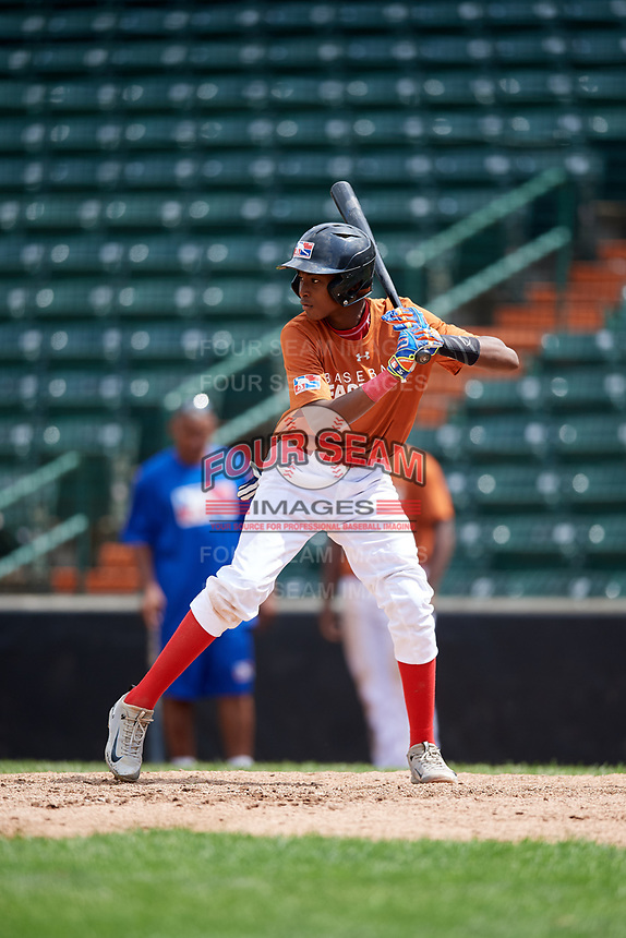 Jonathan Bautista (9) at bat during the Dominican Prospect League Elite Underclass International Series, powered by Baseball Factory, on July 21, 2018 at Schaumburg Boomers Stadium in Schaumburg, Illinois.  (Mike Janes/Four Seam Images)