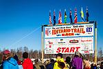 Iditarod Trail Race 2014 Start sign against blue sky, Willow, Southcentral Alaska, Winter.