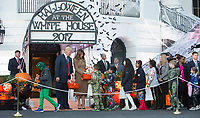 United States President Donald J. Trump and First Lady Melania Trump give out treats during a Halloween event at The White House in Washington, DC, October 30, 2017. Photo Credit: Chris Kleponis/CNP/AdMedia
