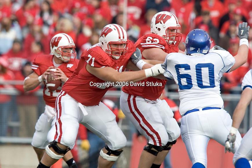 MADISON, WI - NOVEMBER 18: Offensive linemen Eric Vandenheuvel #71 and Kraig Urbik #63 of the Wisconsin Badgers block as quarterback Tyler Donovan drops back to pass against the Buffalo Bulls at Camp Randall Stadium on November 18, 2006 in Madison, Wisconsin. The Badgers beat the Bulls 35-3. (Photo by David Stluka)
