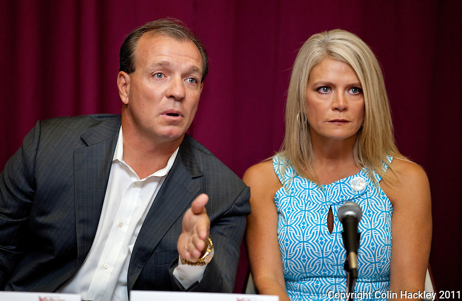 TALLAHASSEE, FLA. 8/4/11-FISHER080511 CH-Florida State University Head Football Coach Jimbo Fisher, left, is joined by wife Candi as they talk about Fanconi anemia, a rare blood disorder their six-year-old son Ethan was diagnosed with earlier this year, Friday during a news conference in Tallahassee. While Ethan is healthy now, doctors anticipate he will need a bone marrow transplant in the future to combat the disease. The Fishers announced the creation of the Kidz 1st Fund to raise money to fund research to find a cure for the disease..COLIN HACKLEY PHOTO