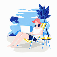 Woman using laptop on holiday sitting in deckchair