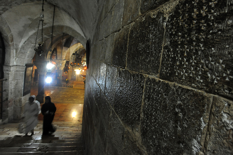 Crosses that were carved by Christian pilgrims throughout the years, on a wall at the Church of the Holy Sepulchre in Jerusalem's old city, Israel. The church sits on the site where Jesus Christ is believed to have been crucified and buried.