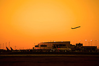 A Jet Airline takes off over the Austin Airport Terminal during a beautiful golden sunset at Austin–Bergstrom International Airport (ABIA)in Austin, Texas.