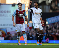 Pictured: David N'Gog of Swansea (R) making his debut. 01 February 2014<br /> Re: Barclay's Premier League, West Ham United v Swansea City FC at Boleyn Ground, London.