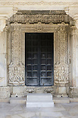 India; road from Udaipur to Jodhpur. Ranakpur Jain Temple. Doorway.