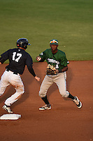 Daytona Tortugas second baseman Carlton Daal (4) checks the runner after forcing out Tyler Wade (17) during a game against the Tampa Yankees on April 24, 2015 at George M. Steinbrenner Field in Tampa, Florida.  Tampa defeated Daytona 12-7.  (Mike Janes/Four Seam Images)