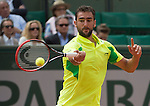 Marin Cilic (CRO) loses the first two sets against Novak Djokovic at  Roland Garros being played at Stade Roland Garros in Paris, France on May 30, 2014