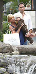 6-13-09 Exclusive .Jaime Pressly shopping at the Calabasas Commons shopping center in Calabasas California with her mother kid and new boy friend.  They were watching the turtles in the fountain looks like Jaime has a little baby bump...AbilityFilms@yahoo.com.805-427-3519.www.AbilityFilms.com