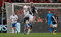 Michael Bradley challenges for a high ball. .The USA men fell to the Netherlands 2-1 at Amsterdam ArenA, Wednesday, March 3, 2010.