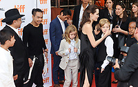 11 September 2017 - Toronto, Ontario Canada - Kimhak Mun, Rithy Panh, Maddox Jolie-Pitt, Pax Jolie-Pitt and Angelina Jolie, Sareum Srey Moch, Loung Ung, Kimhak Mun, Rithy Panh, Maddox Jolie-Pitt, Pax Jolie-Pitt and Angelina Jolie, Vivienne Jolie-Pitt, Knox Jolie-Pitt, Shiloh Jolie-Pitt, Zahara Jolie-Pitt. 2017 Toronto International Film Festival - &quot;First They Killed My Father&quot; Premiere held at Princess of Wales Theatre. <br /> CAP/ADM/BPC<br /> &copy;BPC/ADM/Capital Pictures