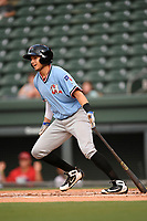 Second baseman Kole Enright (22) of the Hickory Crawdads follows through on a swing during a game against the Greenville Drive on Monday, August 20, 2018, at Fluor Field at the West End in Greenville, South Carolina. Hickory won, 11-2. (Tom Priddy/Four Seam Images)
