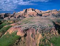 SDBD_030 - USA, South Dakota, Badlands National Park, North Unit, Pinnacles rise above grass and sedimentary formations near Dillon Pass.
