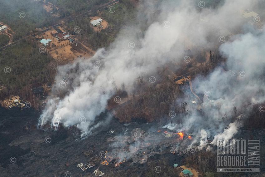 May 2018: An aerial view of the Kilauea Volcano eruption flows into Leilani Estates, Puna, Big Island of Hawai'i.