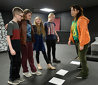 NWA Democrat-Gazette/ANDY SHUPE<br /> Jules Taylor (right), a longtime performer and instructor, works Wednesday, March 20, 2019, with actors Ethan Fox, 11 (from left); Sophie Moody, 12; Haleigh Staley, 11; and Josie Riggins, 11, as they stage an original musical theater piece during Musical Theater Camp at Arts Live Theatre in Fayetteville. The longtime children's theater plans a performance of Junie B. Jones The Musical May 2-5 and will host summer theater camps during the summer.