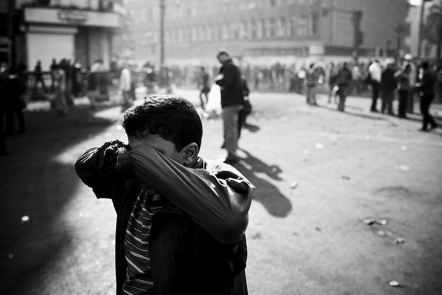 A young Egyptian boy reacts after being exposed to tear gas during protests near central Cairo's Tahrir Square, November 20, 2011.  Photo: Ed Giles.