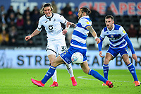 Conor Gallagher of Swansea City under pressure from Geoff Cameron of Queens Park Rangers during the Sky Bet Championship match between Swansea City and Queens Park Ranger at the Liberty Stadium in Swansea, Wales, UK. Tuesday 11 February 2020